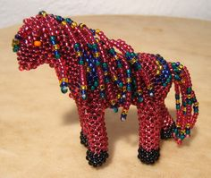 """INDIAN BEADWORK #7190 ARTIST: WELL KNOWN ZUNI BEADWORK ARTIST FARON GAHACHU  MATERIALS USED:  FULLY BEADED WITH SIZE # 11 TRADITIONAL GLASS """"SEED"""" BEADS  SIZE:  2 5/8"""" L x 2 1/4"""" H  TRADITIONAL/ PEYOTE STITCH  ARROW PATTERN ~ GORGEOUS COLORS ~ LONG FRINGED MANE AND TAIL"""
