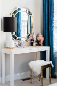 Parsons desk vanity with faux bamboo mirror and gold stool - One Room Challenge reveal.