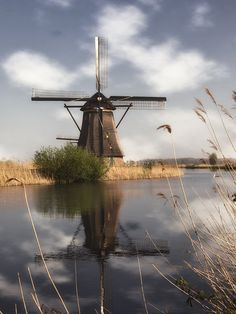 In 1740 a series of windmills were built to drain a polder about southeast of Rotterdam. Today 19 of the Dutch icons survive at Kinderdijk, a Unesco monument. You can wander the dikes for more than amid the spinning sails. Tilting At Windmills, Holland Windmills, Art Sites, Le Moulin, Beautiful Wall, Belle Photo, Netherlands, Fine Art America, Art Photography