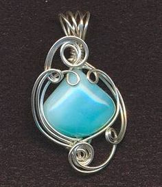Love this wrapped opal pendant... really want to learn how to do this kind of wire wrapping!