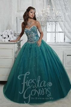 Tulle ball gown with beading detail on the strapless sweetheart neckline and bodice. Lace-up back. Download the Fiesta Gowns by House of Wu sizing chart here. *Note lead times for dresses will vary. A