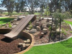 natural playscape with slide