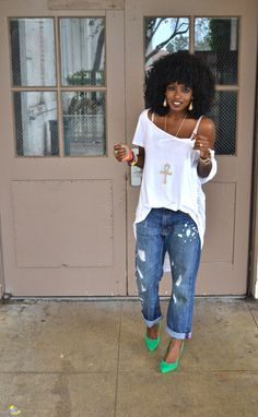 Ripped denim, white tee, green heels.