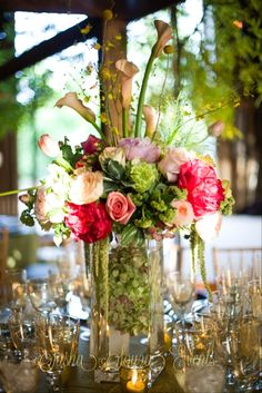 Daily Pretty: Tall early summer centerpiece with blush pink and fuchsia peonies, green viburnum, apricot tulips, oncidium orchids, Ecuadorian and garden roses, hypericum berry, peach calla lily, yellow crespedia, green amaranth and whole head hydrangea. Image by Paul Morse