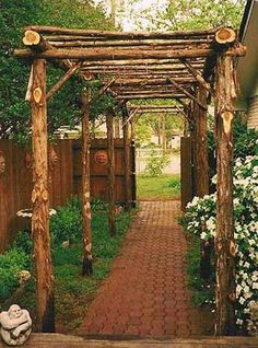 This rustic pergola is perfect for this garden design. I really like it but would rather have it away from the house.