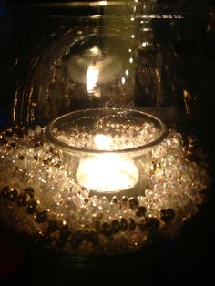 Shimmering white and gold bead garland that I wasn't sure what to do with- they are in glass fishbowls with tea lights