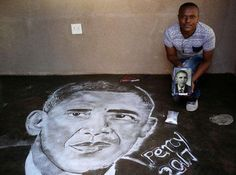Percy Maimela, a self taught artist, poses next to a portrait of former U.S. President Barack Obama which he draws using salt, at his home in Pretoria