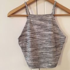 Marbled Grey High Neck Crop Top Grey Marbled Crop Top. Brand new. Never worn. Two tone sleeveless crop top. 54% rayon, 46% polyester. Available in S-M-L. No trades. 10% discount on all bundles made with the bundle feature. No offers will be considered unless you use the make me an offer feature.      Please follow  Instagram: BossyJoc3y  Blog: www.bossyjocey.com Tops Crop Tops