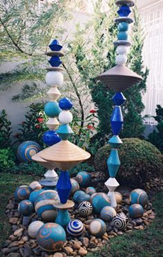 DIY garden art - over rebar slide mini painted terra cotta pots that are glued opening to opening and assorted bowls that are glued the same and painted balls and painted coasters drilled with holes. Paint balls to scatter around.
