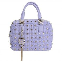 Versace Iconic Quilted and Studded lilac leather bag ($2,690) ❤ liked on Polyvore featuring bags, handbags, tassel handbag, studded handbags, real leather handbags, quilted leather purse and quilted purses