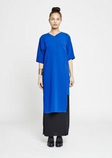 Cobalt blue Crepe wool V-neckline Hidden popper buttons Mid-Length sleeves Shorter back hem