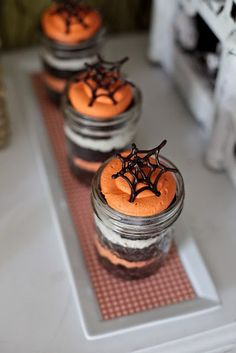 Halloween layered cake in jars with spider web toppers