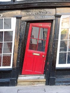 Cockeyed red door. Canterbury, England