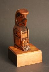 8 Inch Eagle Totem Pole This 8 inch eagle totem pole is hand carved by Native Jack Stogan, from red cedar with a light stain. His signature is etched into the back of the piece. Eagle Totem, Tlingit, Totem Poles, Red Cedar, North West, Nativity, North America, Hand Carved, Native American