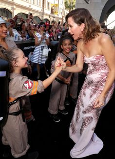 """So, strong leading ladies are more than important. Girls can be heroes too."" Kristen Wiig With Young Ghostbusters Fans"