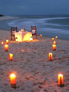 Have A Fancy Dinner On The Beach Wih Candles Music