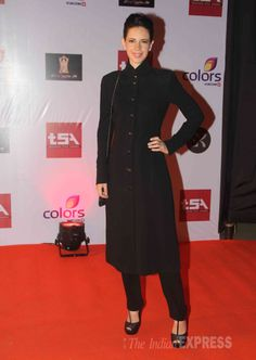 Kalki Koechlin was chic in a black buttoned up coat with matching heels at the Television Style Awards. #Bollywood #Fashion #Style #Beauty