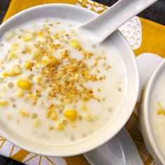 Chè Bắp (Vietnamese Sweet Corn Pudding) Serves 10  3 large ears corn, shucked 4 cups water 2 pandan leaves, tied together and knotted (optional) 1/4 cup small tapioca pearls 2 (14-ounce) cans coconut milk 1/2 cup granulated sugar Pinch salt 2 tablespoons toasted sesame seeds
