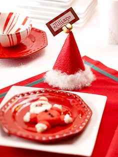 Santa Hat Place Cards for Christmas.Santa Hat Place Cards Welcome Christmas guests to your table with Santa hat place cards. The glittery fur-trim hats also make great party favors. Christmas Place Cards, Christmas Table Settings, Christmas Tablescapes, Christmas Table Decorations, All Things Christmas, Winter Christmas, Christmas Holidays, Merry Christmas, Christmas Place Setting