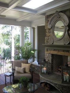 Beautiful outdoor living space, great colors...love the plantation shutters and fireplace design.