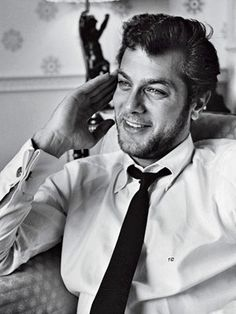 Funny, gorgeous Tony Curtis. Men look better when they're at their most rugged.....very masculine!! CF