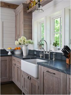 Cerusing is a wood finishing technique that involves the application of whiting and rubbing the whiting into the grain of a wood, then hand waxing it.  Cerusing adds contrast in order to highlight the beauty of a wood's grain, typically oak.  Interior Design: Shelter Interiors, LLC, Connecticut - Carolyn Kron and Tricia Izzo