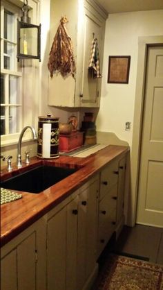 Redo our countertops in this stain? Warmer shade, looks great with paint color.