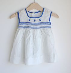 Vintage 1960's Baby Girl Dress - White with Blue DUCKS and Smocking (0 to 3m). $17.00, via Etsy.