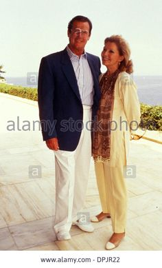 ROGER MOORE AND WIFE LUISA IN ATHENS 1993  - DPJR22 from Alamy's library,