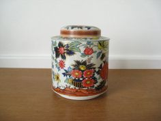 Daher tin canister with asian floral motif by Sweetpotatojack, $12.00