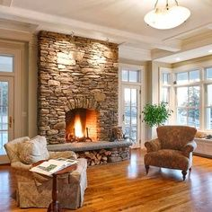 fireplaces with windows on each side   Veneer stone fireplace surround.