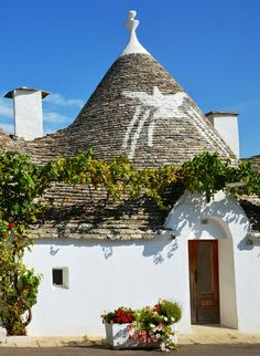 Stroll through #Alberobello, the UNESCO World heritage site, with our luxury Cooking and Wine tasting holiday package! #AriaLuxuryApulia #trulli #puglia