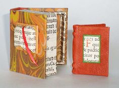 A Good Book (2009). 1 1/2 x 1 1/4 inches. The text is a quote by Kathleen Norris. This quote speaks of the comfort of a good book! There are four watercolor paintings featuring reading, books and a view of Norris' home in Palo Alto. The paper used to make this book include hand marbled, Peter's handmade and paper from a very old book (17th Century!). It is full bound in copper colored leather. There is a leather covered raised panel on the front with a label of the old paper.