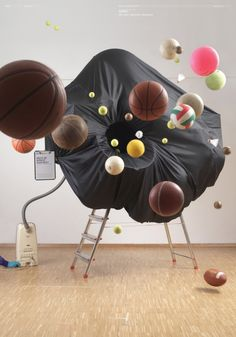 German designer Katrin Schacke created this illustration of a black hole using common household items. http://www.printmag.com/Article/Katrin-Schacke