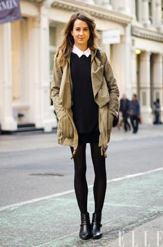 Black tights, black skirt, anorak.
