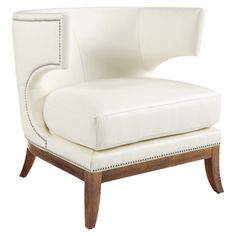Klismos-style wingback chair in ivory bonded leather with silver nailhead trim.   Product: ChairConstruction Material: