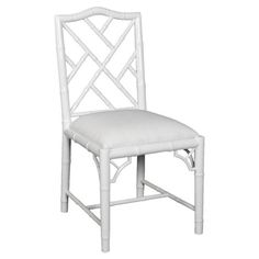 Perfect pulled up to your bistro table or writing desk, this stylish side chair is artfully handcrafted from mahogany and features a white lacquer finish.