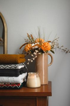 The coming of the Fall season is a sign that you should change your decor so that your home feels warmer and cozier. Here are 7 awesome tips on how to make your home cozy for fall. Artificial Flower Arrangements, Artificial Flowers, Fall Home Decor, Autumn Home, Unique Home Decor, Planting Pumpkins, Autumn Aesthetic, Flower Aesthetic, Fall Sweaters