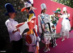 Dutch-Russian designer Danial Aitouganov (L) prepares models backstage before presenting creations to the jury on April 28, 2017 during the 32nd edition of the International Festival of Fashion and Photography in the French southern city of Hyeres. /