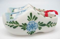 These cute little ceramic wooden shoes are made of high quality ceramic painted with a splash of color in the classic Dutch style of Delft Blue from Holland. Great for party favors or gifts. - Windmil
