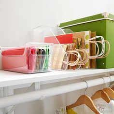 For those who prefer gift bags and tissue paper, this ultra-efficient gift-wrap storage option is for you. Tucked on a shelf in a bedroom closet, clear containers (a plastic refrigerator bin and a magazine holder set on its spine) organize tissue paper and gift bags. Place bag handles facing out so they are easy to grab./