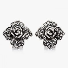 $3.95  Vintage Flower Rose Earrings  This clip earring accents a rose flower surrounded by four filigree detailed leaves. The flower earrings are crafted in oxidized effect alloy with omega clip.