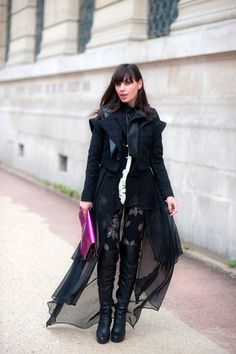 Only I'm guessing in Paris could you dress so gothic to the teeth (and a pink clutch to boot) and have it WORK. #WayneTippetts.