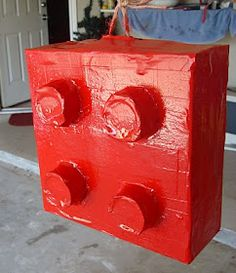maybe this one??  Lego pinata (box, cups, mache, spray paint)
