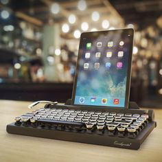 A vintage typewriter-inspired Bluetooth mechanical keyboard to beautify your desktop! Features include:Qwerkywriter connects wirelessly via Bluetooth to iPhones, iPads, iMacs, MacPros, Macbooks, Android Tablets Devices, Windows Tablets, and more. Qwerkywriter features industrial strength mechanical switches that provide a unique clicky tactile feel. Qwerkywriter's Return Bar functions as an ENTER key by default. But it's also programmable, remembering up to 5 characters. Simply hold…