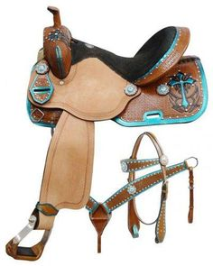 """14"""", 15"""", 16"""" Double T barrel style saddle set with metallic teal painted cross This saddle features basket weave tooled skirts, pommel and cantle accented with metallic painted trim and a metallic pa"""