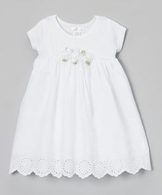 Dainty flower accents and lovely eyelet detailing make this dress the perfect complement to any sweet darling. With a roomy cut and comfy cotton construction, it goes easily from party to play.