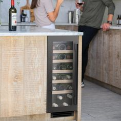 undercounter wine cooler in gunmetal. Suitable for red, white and sparkling wine. The UK's number one brand of wine coolers Wine Cabinets, Black Cabinets, Air Ventilation, Sliding Shelves, Bordeaux Wine, Wine Chiller, Sink Taps, Bottle Sizes, Champagne Bottles