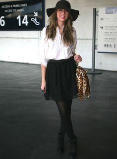 Black hat, white button up, black skirt or tutu, black sheer tights, black boots