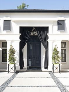 Black doors white walls entry mediterranean with blue shutters black tile Roof Design, Exterior Design, Interior And Exterior, House Design, Bahama Shutters, Blue Shutters, Outdoor Drapes, Indoor Outdoor, Outdoor Shutters